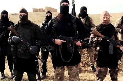 """Mandatory Credit: Photo by REX USA (2642870a)  Hayat Boumeddiene, far right  Hayat Boumeddiene 'appears in Islamic State film' - 06 Feb 2015  The latest video released by French-speaking Islamic state (ISIS), fighters may be Hayat Boumeddiene, who is believed to have knowledge about the deadly January 9, 2015 attack on a Paris kosher grocery,The video, titled """"Blow Up France 2,"""" was released Tuesday and shows an ISIS fighter praising previous attackers in France and calling for new attacks. The video shows a woman standing next to the speaker, wearing camouflage clothing and holding a weapon. French authorities are investigating the possibility this woman could be Hayat Boumeddiene. Her husband, Amedy Coulibaly, killed four hostages January 9 at a kosher grocery in Paris, authorities said. He was killed by police in a rescue and the remaining hostages fled to safety."""